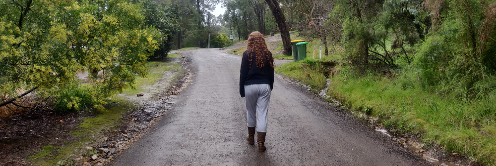 A person walking down a road.